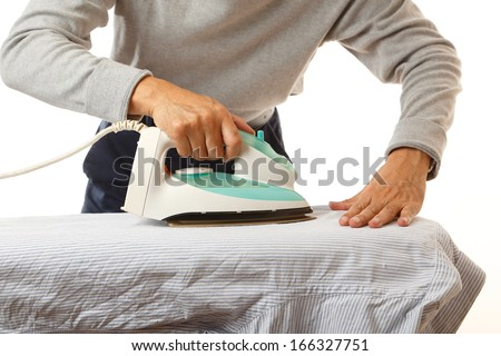 Man doing housework, ironing his shirt. - stock photo