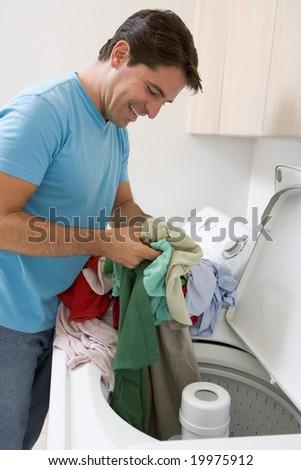 Man Doing Laundry - stock photo