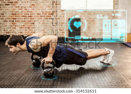 Man doing push ups with kettlebell against fitness interface - stock photo