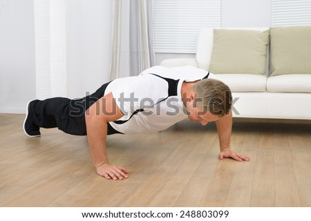 Man Doing Pushup Fitness Exercise At Home - stock photo