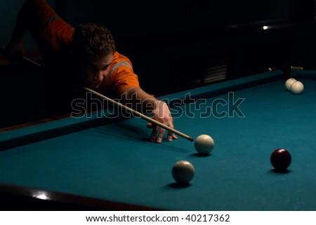 Man doing shoot on billiard - stock photo