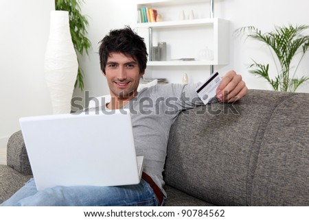 Man doing shopping on the Internet - stock photo