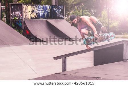 Man doing skateboard tricks. - stock photo