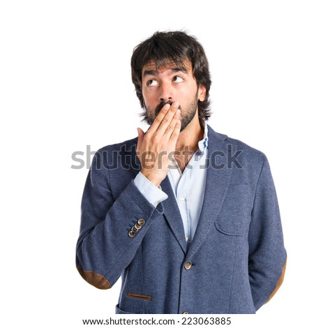 Man doing surprise gesture over white background