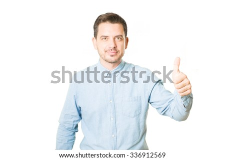 Man doing the thumb up gesture - stock photo