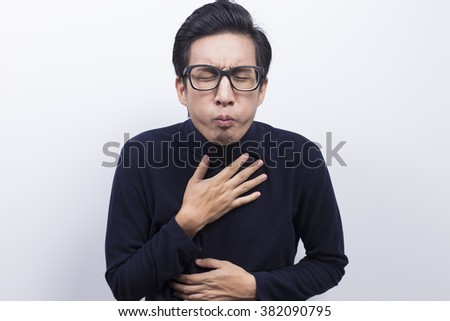 Man doing vomiting gesture - stock photo