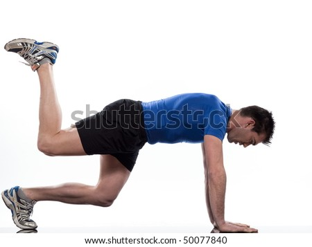 man doing workout on white isolated background - stock photo