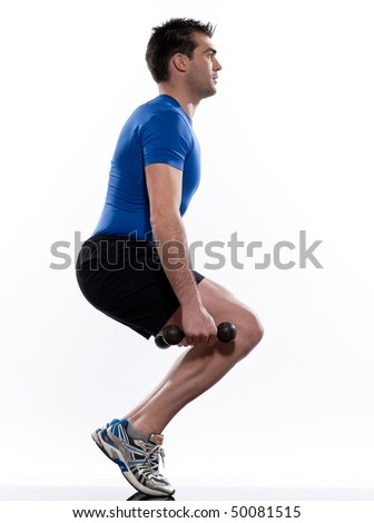 man doing workout squat on white isolated background - stock photo