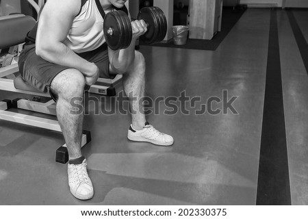 Man doing workout with heavy dumbbell