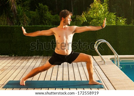 Man doing yoga in the middle of the nature. - stock photo