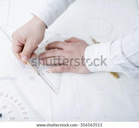 man drawer drawing on map - stock photo