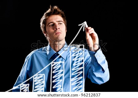Man drawing a chart on the screen - stock photo