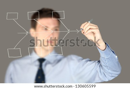 Man drawing a fish bone diagram chart - stock photo