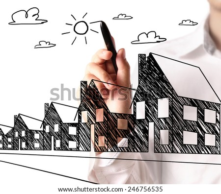 Man drawing a growing real estate chart - stock photo