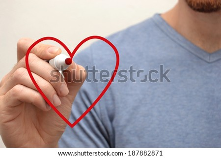 Man drawing a heart
