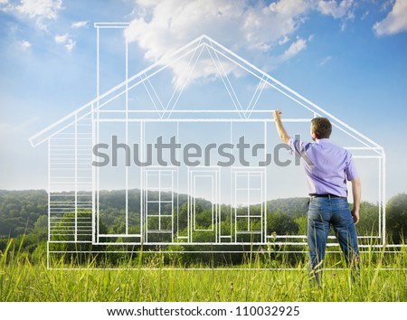 Man drawing a house in a field