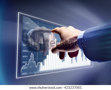 man drawing color graphics devoted to business - stock photo