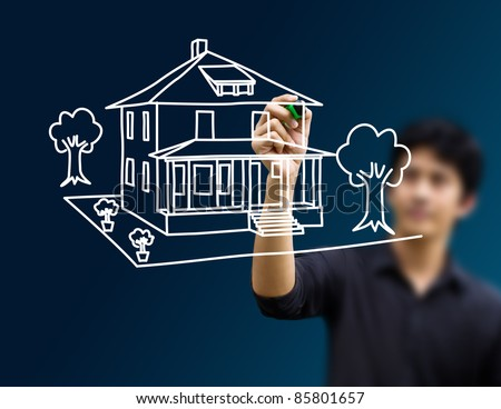 man drawing dream home - stock photo