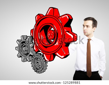 man drawing red gears on white background - stock photo