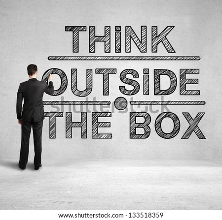 man drawing think outside the box - stock photo