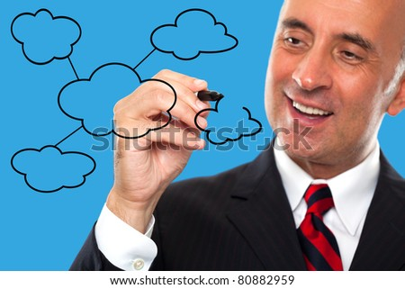 Man draws a diagram for cloud computing - stock photo