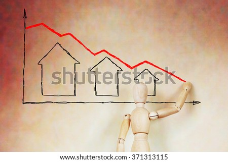 Man draws the graph of real estate price fall. Abstract image with a wooden puppet - stock photo