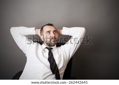 Man dreaming in the office - stock photo