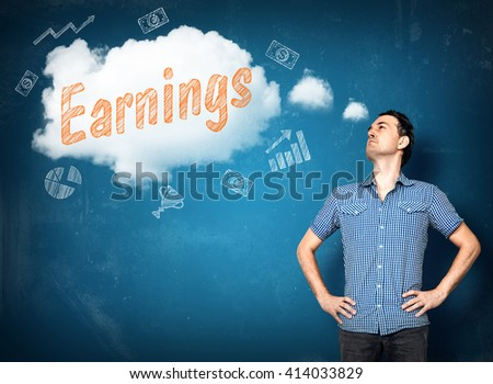 Man dreaming of bigger earnings on blue background - stock photo