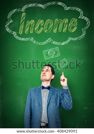 Man dreaming of larger income with money - stock photo