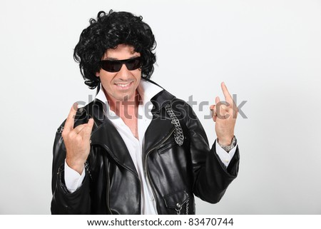 Man dressed as a rock star - stock photo