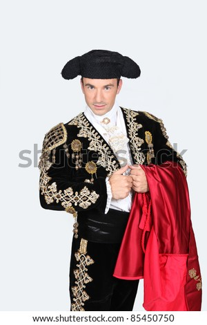 Man dressed as Spanish bull fighter - stock photo