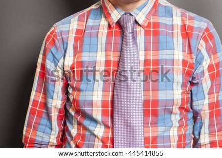 Man Dressed Checkered Shirt With  Tie On Gray Background - stock photo