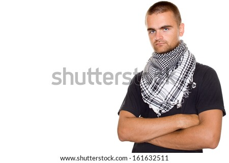 Man dressed in at the neck of a Palestinian scarf. Hands crossed - stock photo