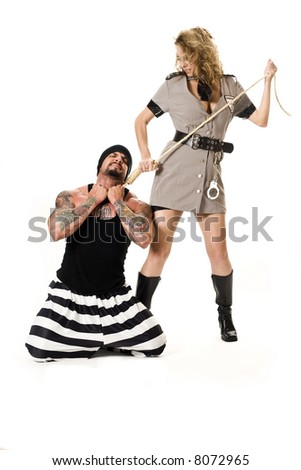 Man dressed in convict costume holding a woman