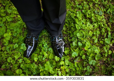 Man dressed in lacquer leather shoes