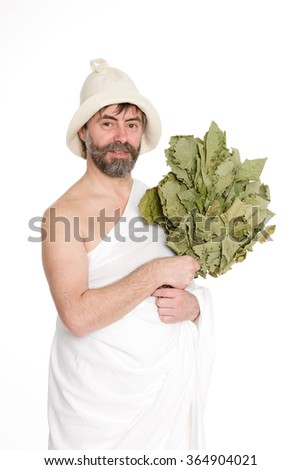 Man dressed in traditional clothes of bath. From a series of Russian bath. - stock photo