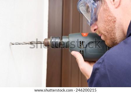 Man drilling - stock photo