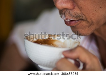 man drink hot coffee