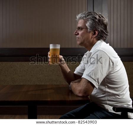 Man drinking alone - stock photo