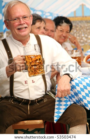Man drinking bavarian beer - stock photo
