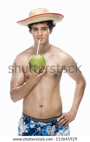 Man drinking coconut milk - stock photo