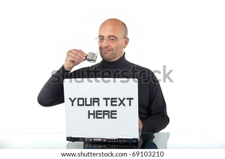 Man drinking espresso and looking happy to his laptop - stock photo