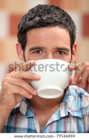 Man drinking from a bowl - stock photo
