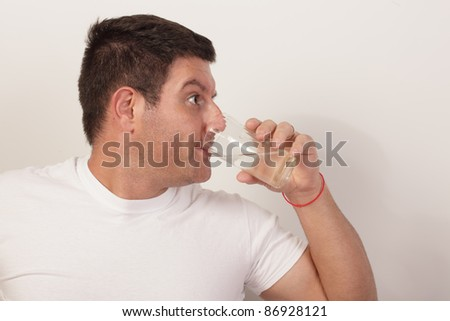 Man drinking from a glass