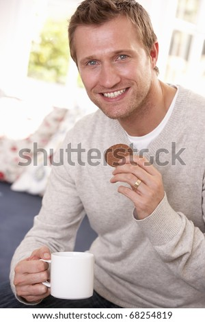 Man drinking from cup - stock photo