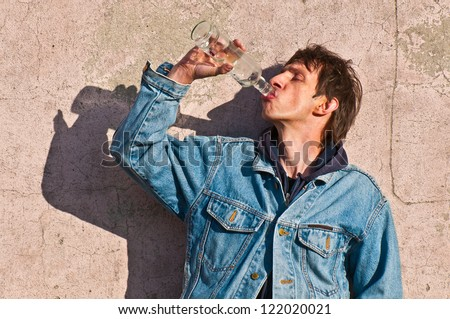 Man drinking vodka - stock photo
