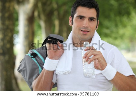 Man drinking water - stock photo