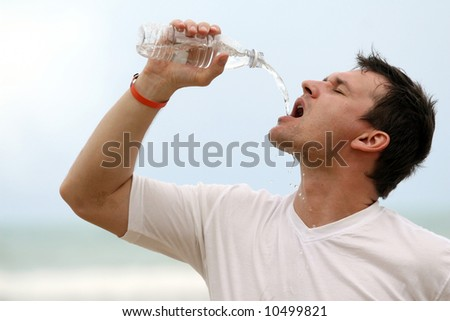 man drinking water after sport training - stock photo