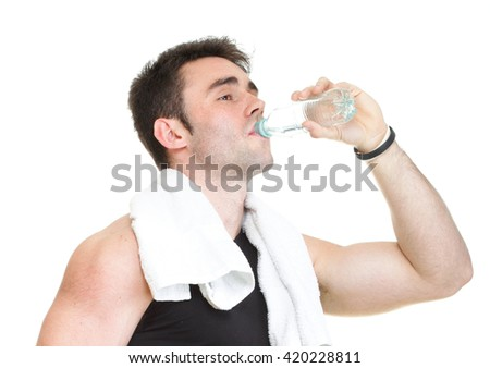 Man drinking water after training. Isolated on white - stock photo