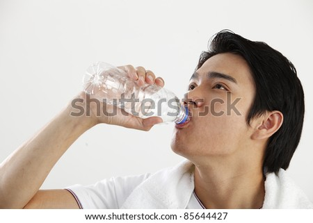man drinking water from bottle - stock photo